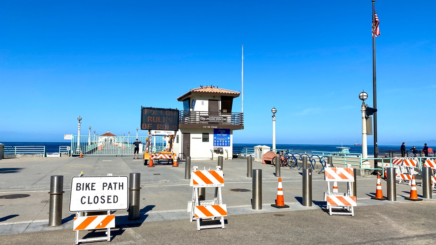 Manhattan Beach pier has been closed due to COVID-19. LA County hopes to reopen the economy and lift stay-at-home restrictions by July 4, 2020.
