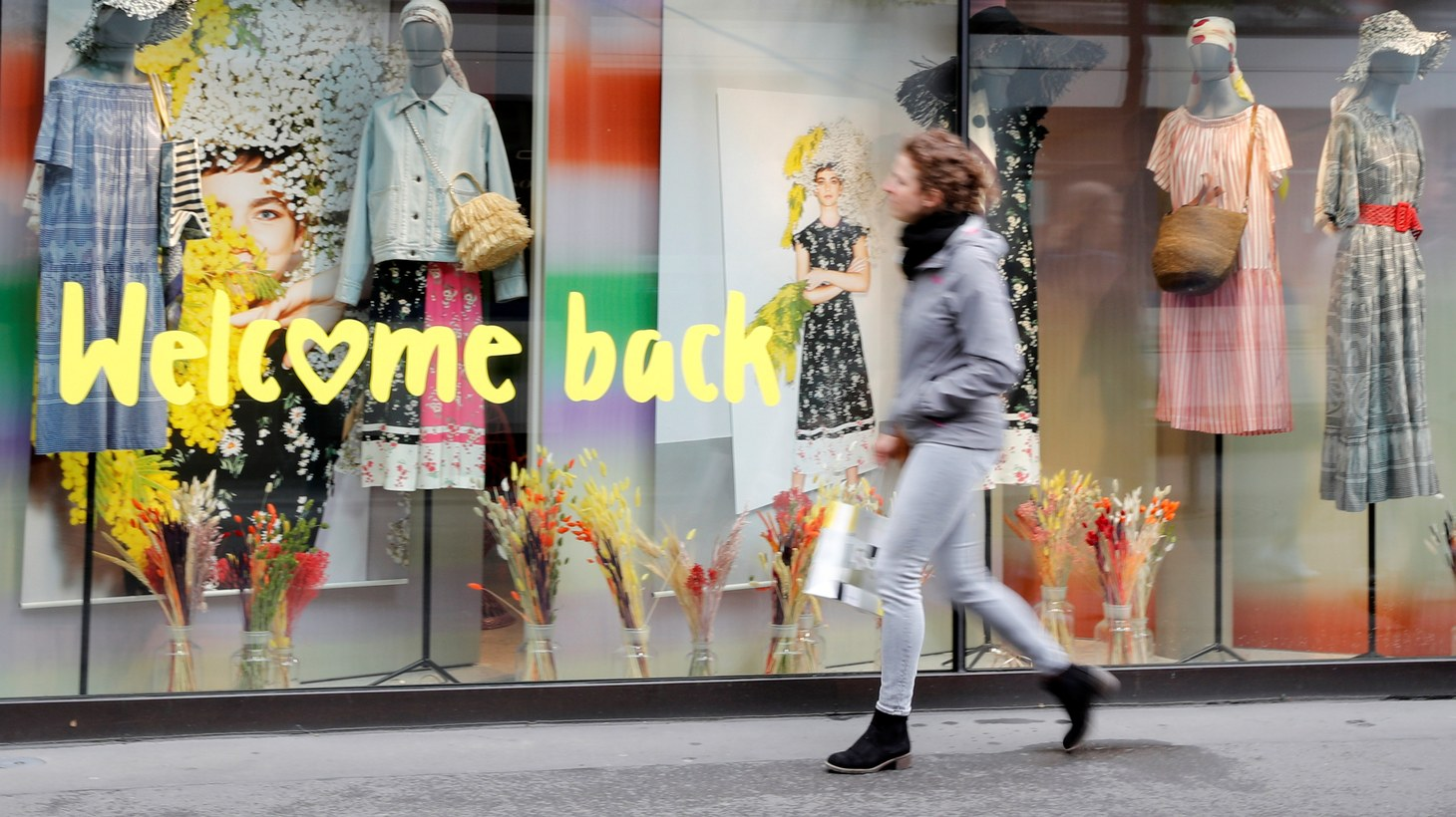 """The slogan """"Welcome back"""" greets clients on the reopening day of a woman's clothing store as Switzerland eases the lockdown measures during the coronavirus outbreak in Zurich."""