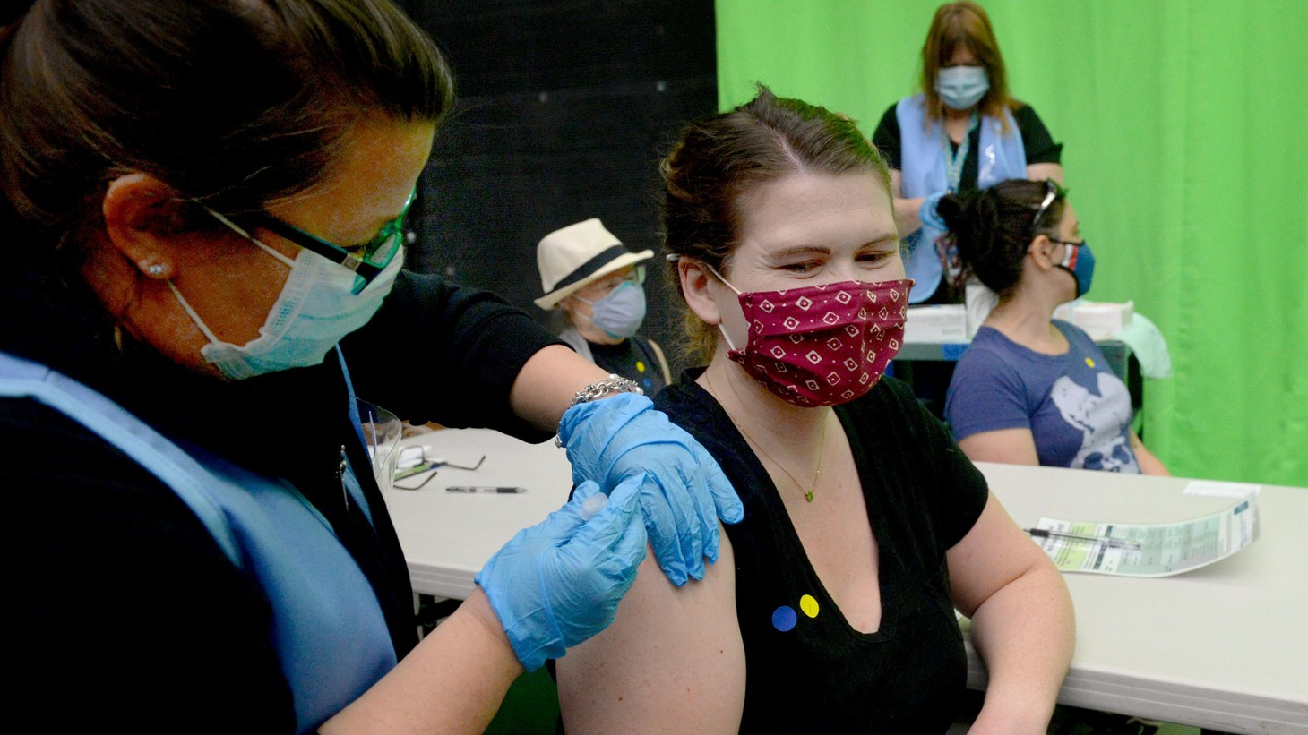 Lisa Vallejo, a nurse for the Simi Valley Unified School District, gives substitute teacher Caroline Sheller a COVID-19 vaccine at the district's two-day vaccine clinic for teachers and staff on Saturday, Feb. 27, 2021.