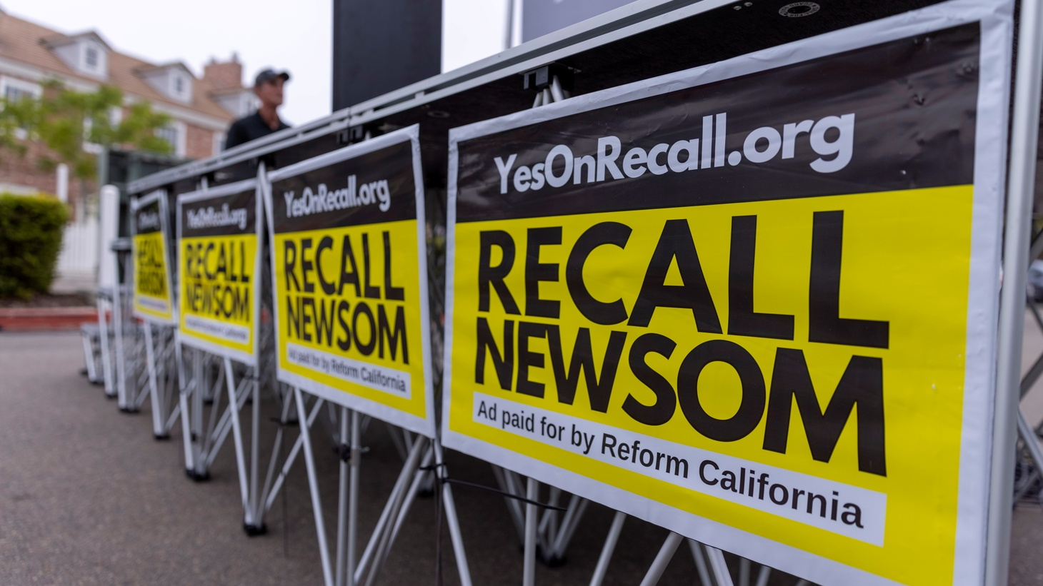Signs are shown at a rally for the recall campaign of California governor Gavin Newsom in Carlsbad, California, U.S., June 30, 2021.