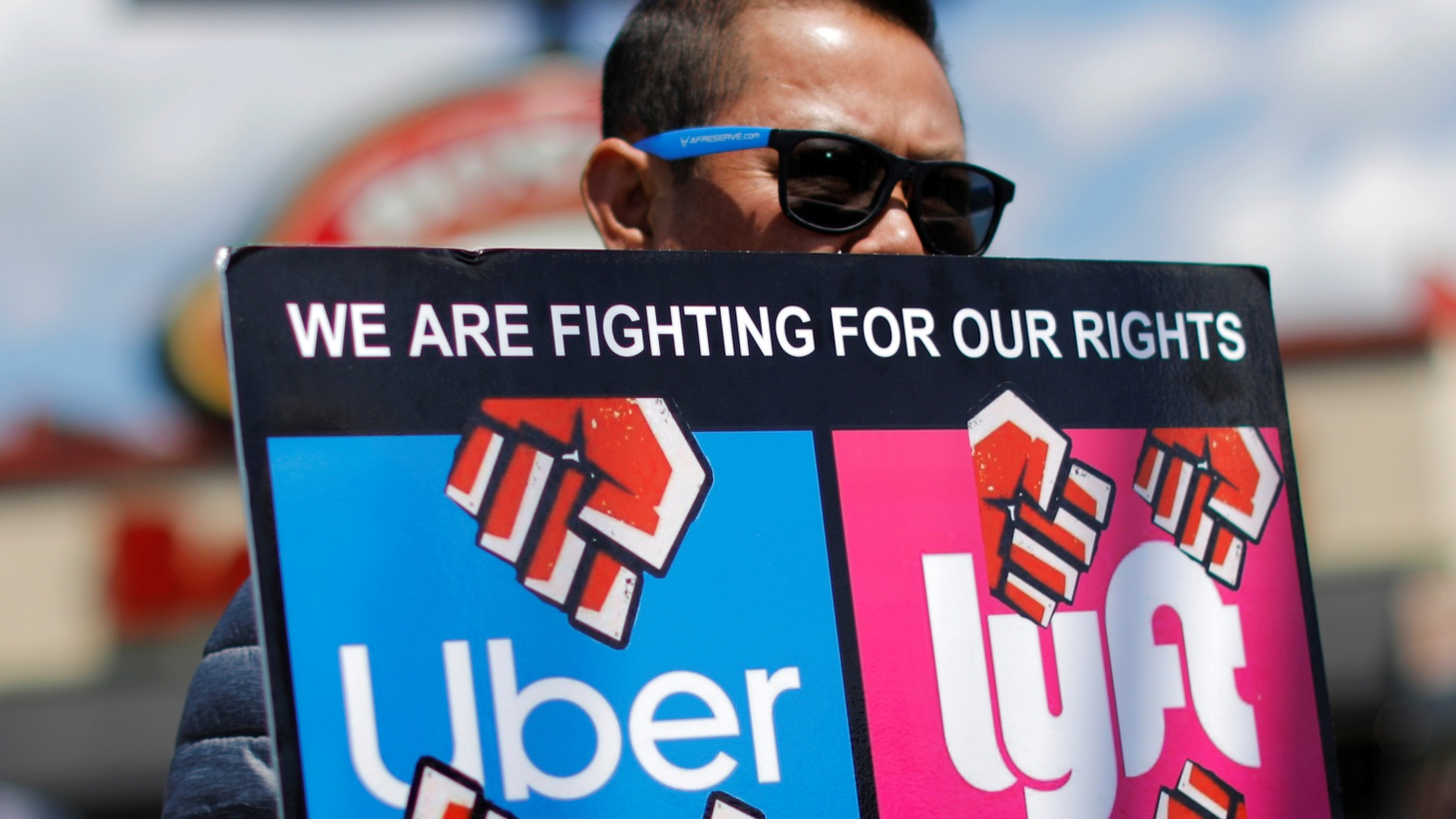 A driver takes part in a protest against Uber and other app-based ride-hailing companies outside the Uber Greenlight offices in the Queens borough of New York, U.S., May 8, 2019.