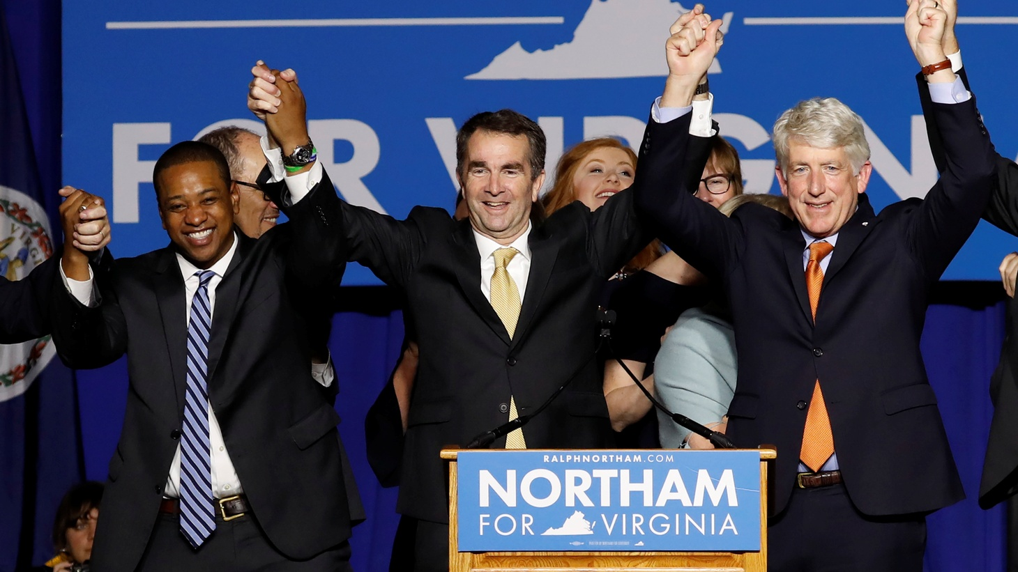 Virginia Governor Elect Ralph Northam (C) celebrates with Lt. Governor Elect Justin Fairfax and Attorney General Mark Herring at his election night rally on the campus of George Mason University in Fairfax, Virginia, November 7, 2017.