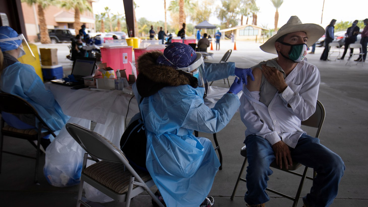 Registered Nurse Erika Williams vaccinates farmworker Francisco Felix as health professions come out to the farming community to deliver vaccinations during the outbreak of the coronavirus disease (COVID-19) in Mecca, California, U.S., February 1, 2021.
