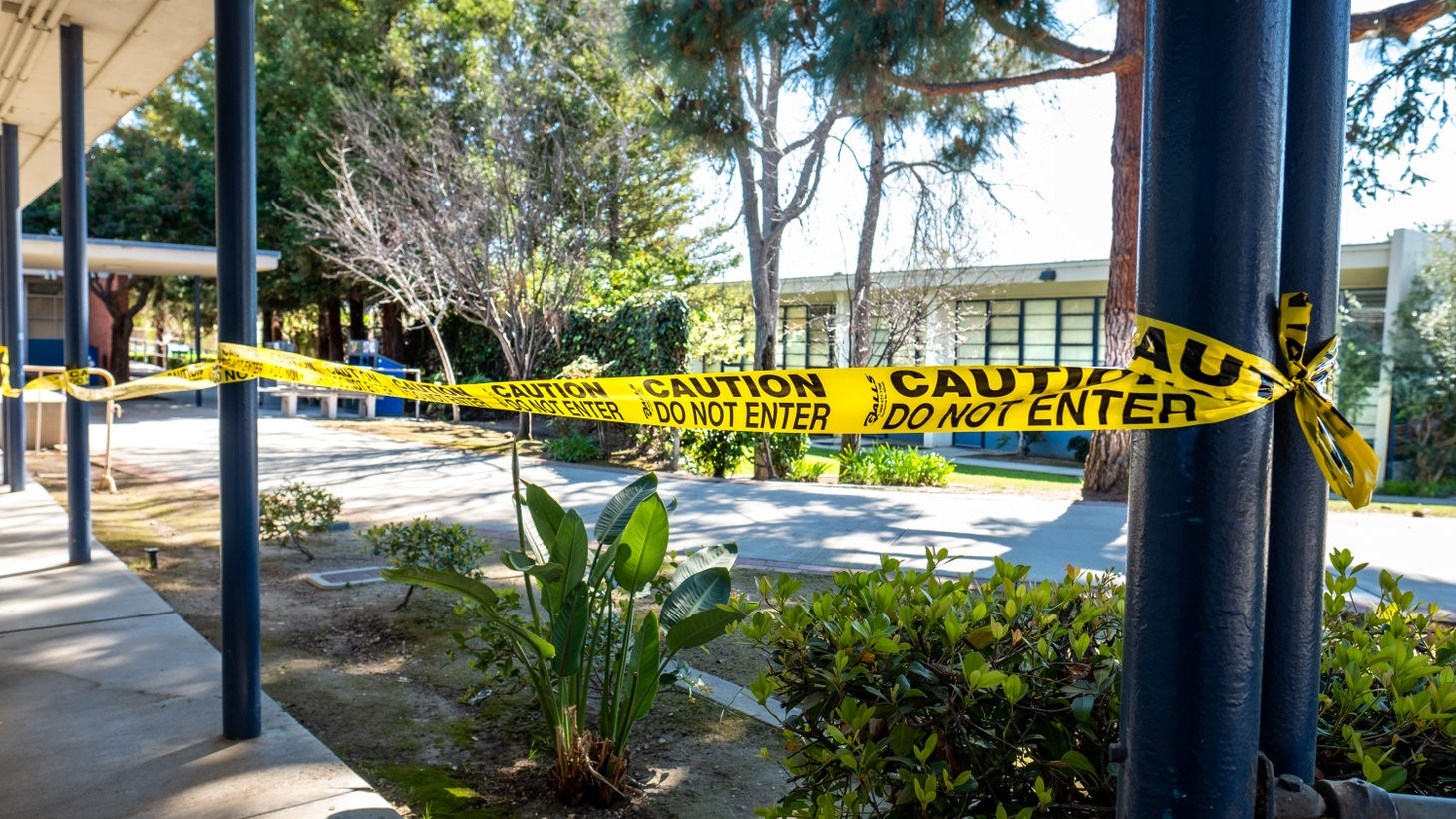 """A section of Culver City Middle School's campus is roped off with """"caution/do not enter"""" tape, March 1, 2021."""