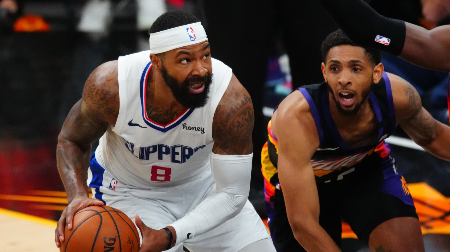 Los Angeles Clippers forward Marcus Morris Sr (8) goes against Phoenix Suns guard Cameron Payne in game five of the Western Conference Finals for the 2021 NBA Playoffs at Phoenix Suns Arena.