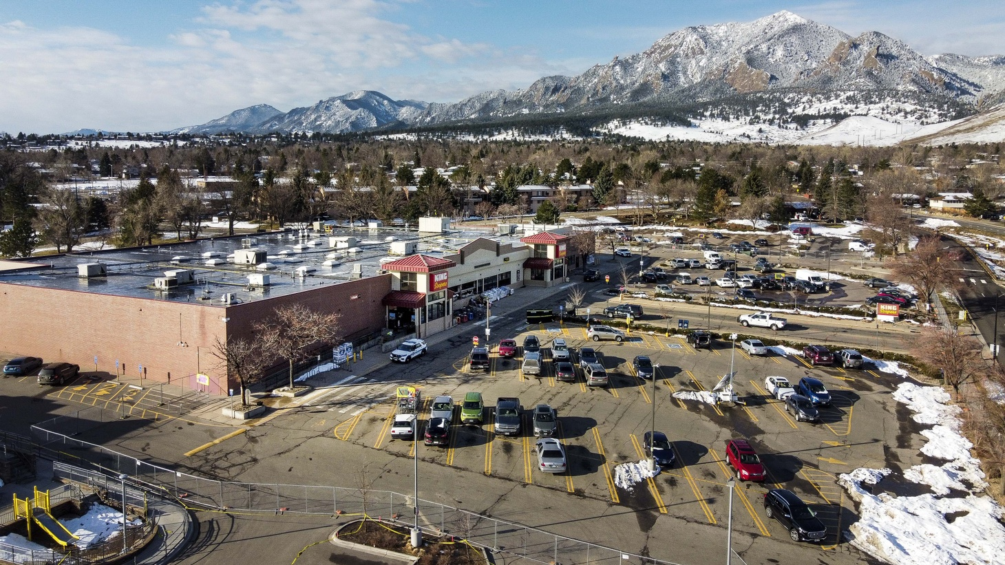 In this aerial photograph from a drone, police officers continue their investigation of a shooting at a King Soopers grocery store where multiple people were killed, including a police officer on March 23, 2021, Boulder, Colorado, USA.