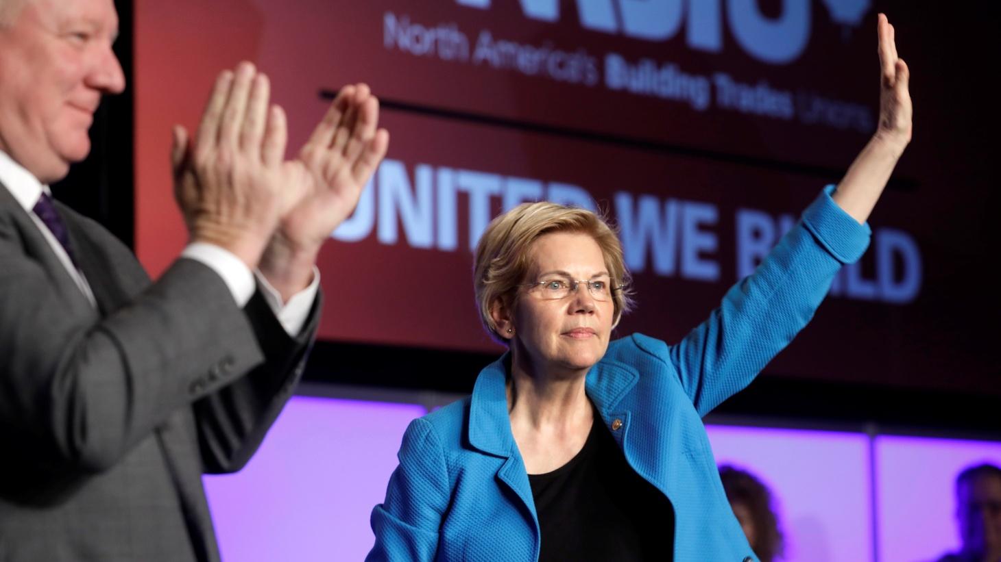 Democratic U.S. presidential candidate Senator Elizabeth Warren (D-MA) waves at the North America's Building Trades Unions (NABTU) 2019 legislative conference in Washington, U.S., April 10, 2019.