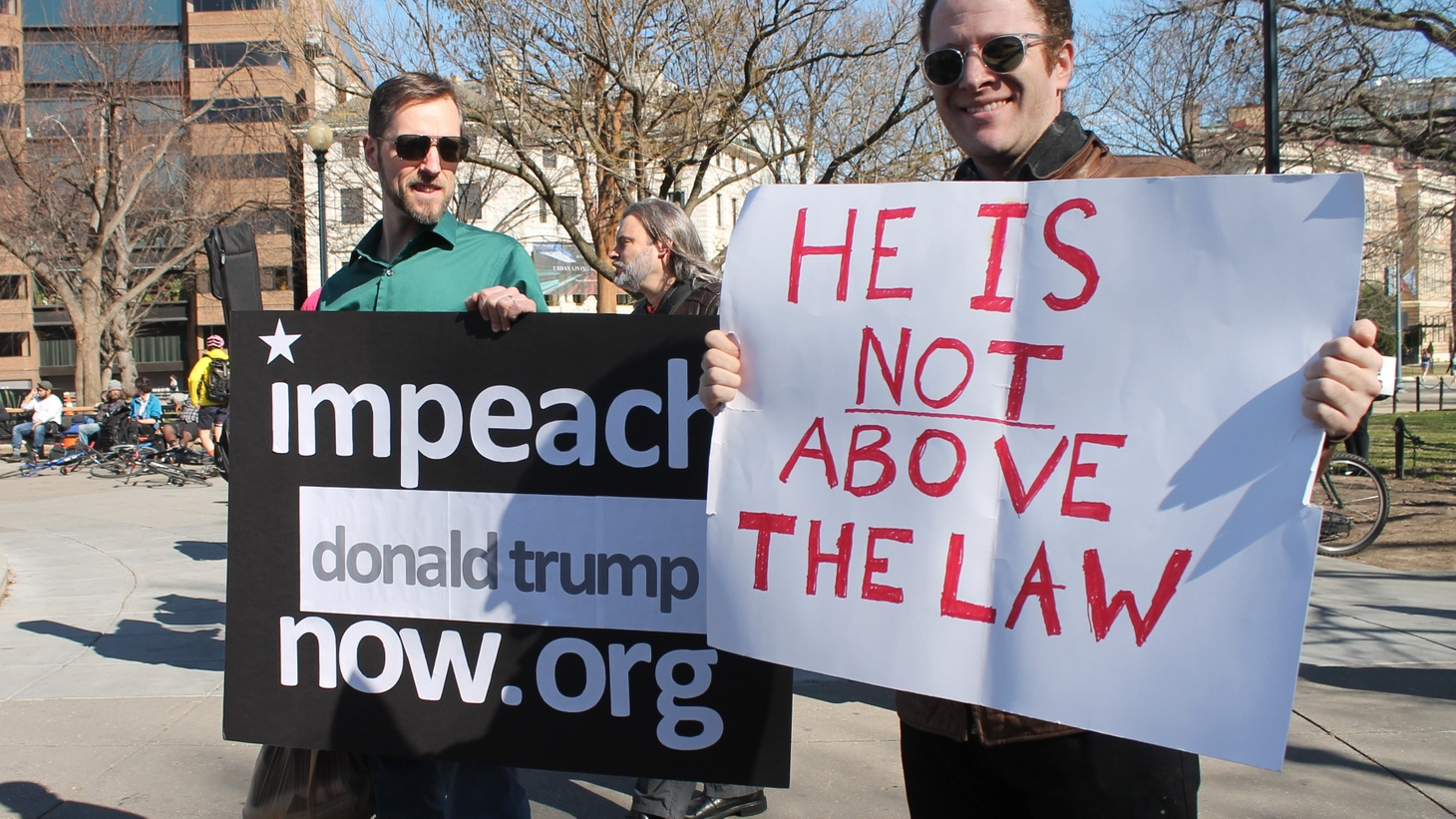 Activists holding impeachment signs in Washington DC.