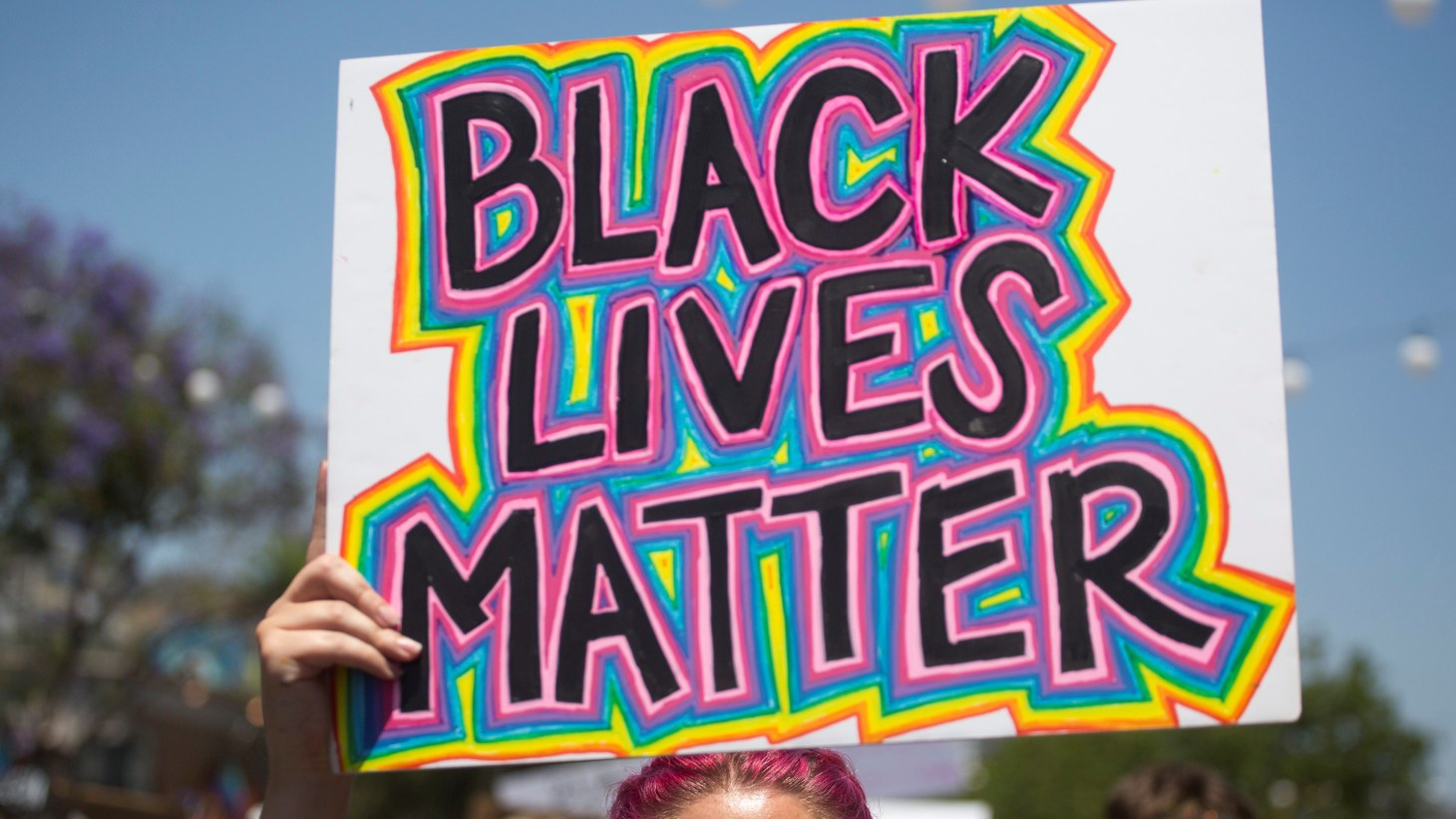 """A person holding a sign reading """"Black Lives Matter"""" takes part in an All Black Lives Matter march, organized by Black LGBTQ+ leaders, in the aftermath of the death of George Floyd, in Hollywood, Los Angeles, California, U.S., June 14, 2020."""
