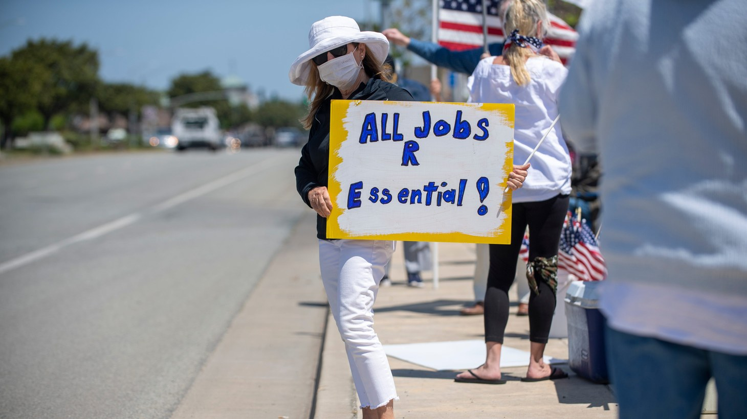 People in Monterey County protest California's stay-at-home orders, expressing their desire to reopen the economy. May 1, 2020.