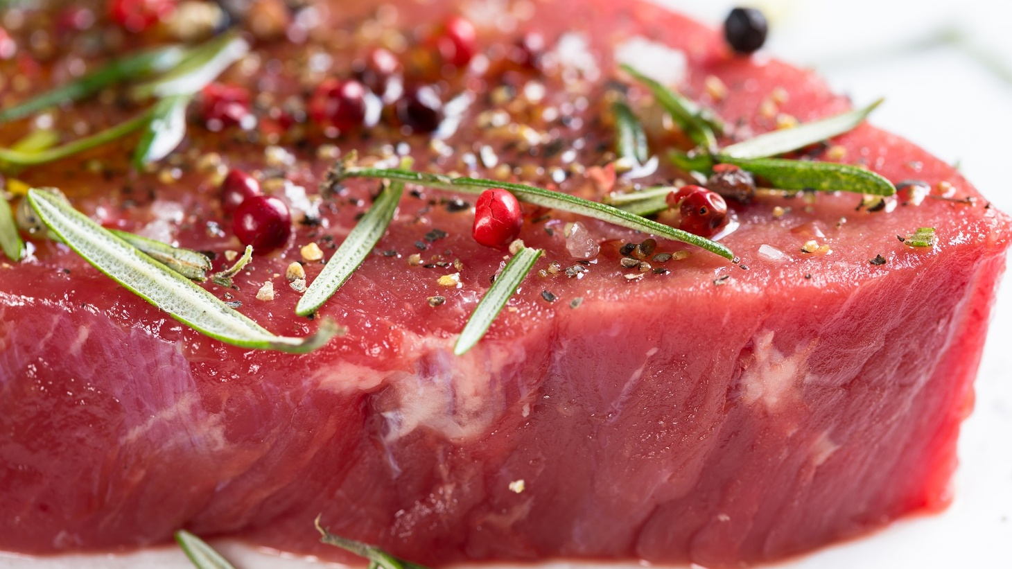 Raw marinated steak.