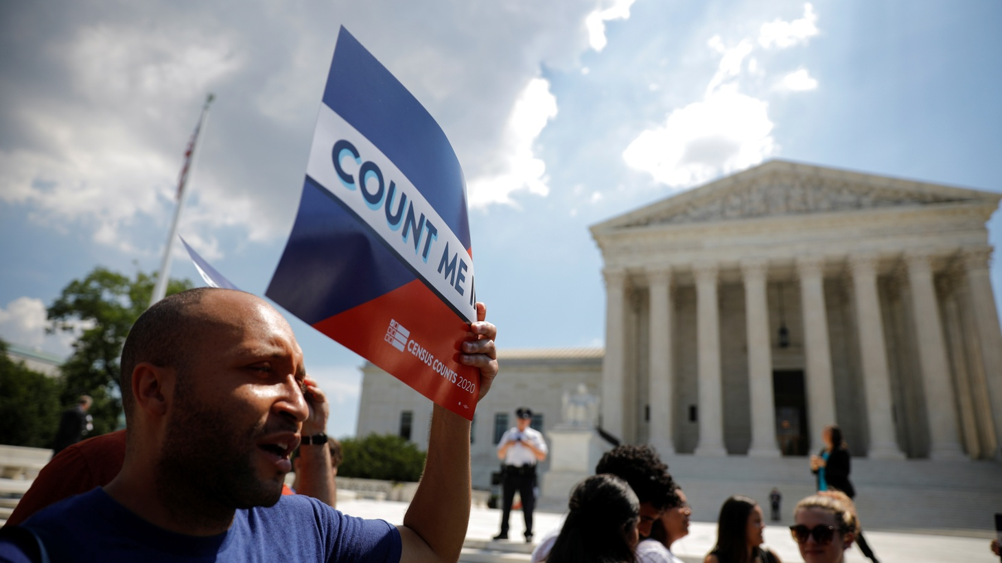 A protester holds a sign outside the U.S. Supreme Court, where the court ruled that the Trump administration did not give an adequate explanation for its plan to add a citizenship question to the 2020 census, delivering a victory to New York state and others challenging the proposal. June 27, 2019.