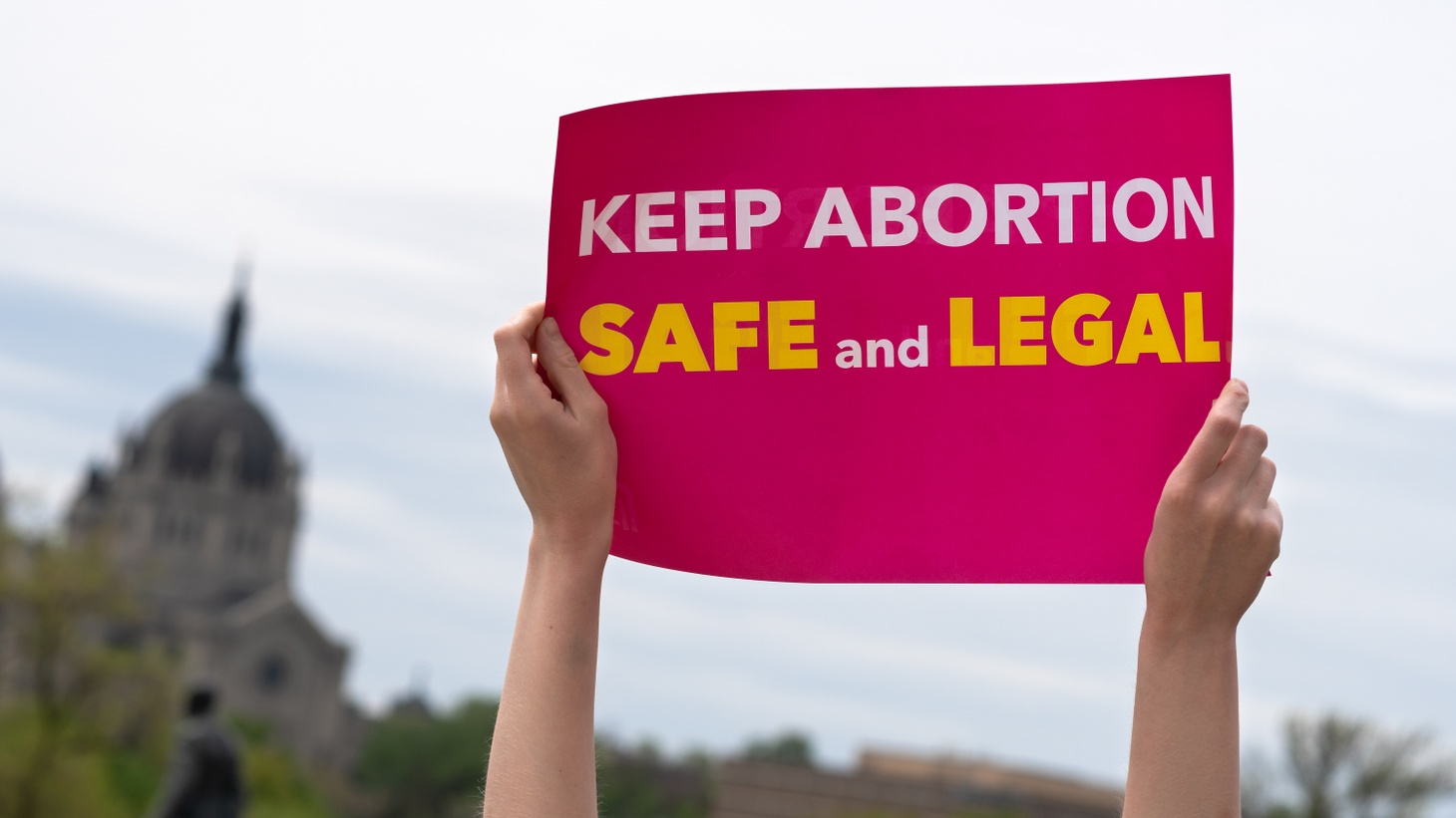 """""""Keep Abortion Safe And Legal"""" sign at a at a rally in St Paul, Minnesota."""
