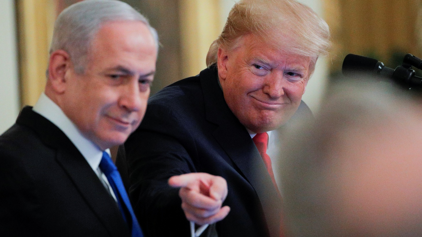 U.S. President Donald Trump points past Israel's Prime Minister Benjamin Netanyahu as they discuss a Middle East peace plan proposal during a joint news conference in the East Room of the White House in Washington, U.S., January 28, 2020.