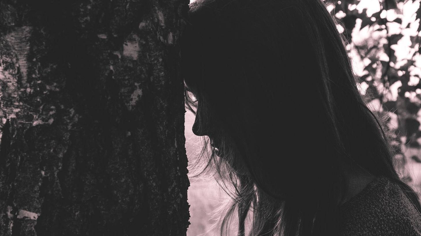 Woman reflecting.