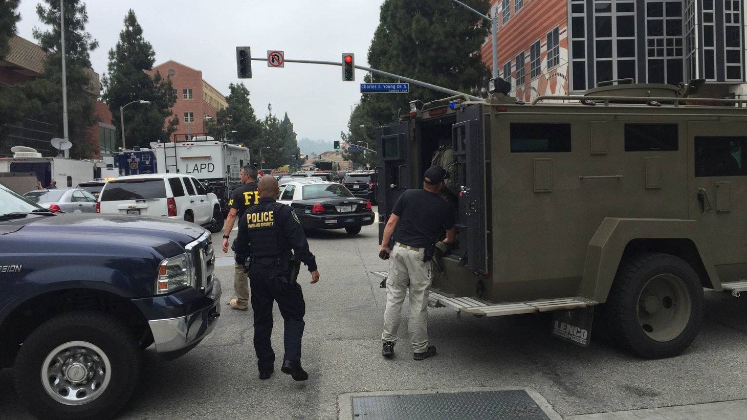 Two men are dead in a  suspected murder-suicide  after a shooting at UCLA Wednesday morning which led to a campus lockdown. KCRW reporter Saul Gonzalez joined Press Play from the University campus with the latest.     Police outside of UCLA's campus on June 1st, 2016 Credit: Saul Gonzalez
