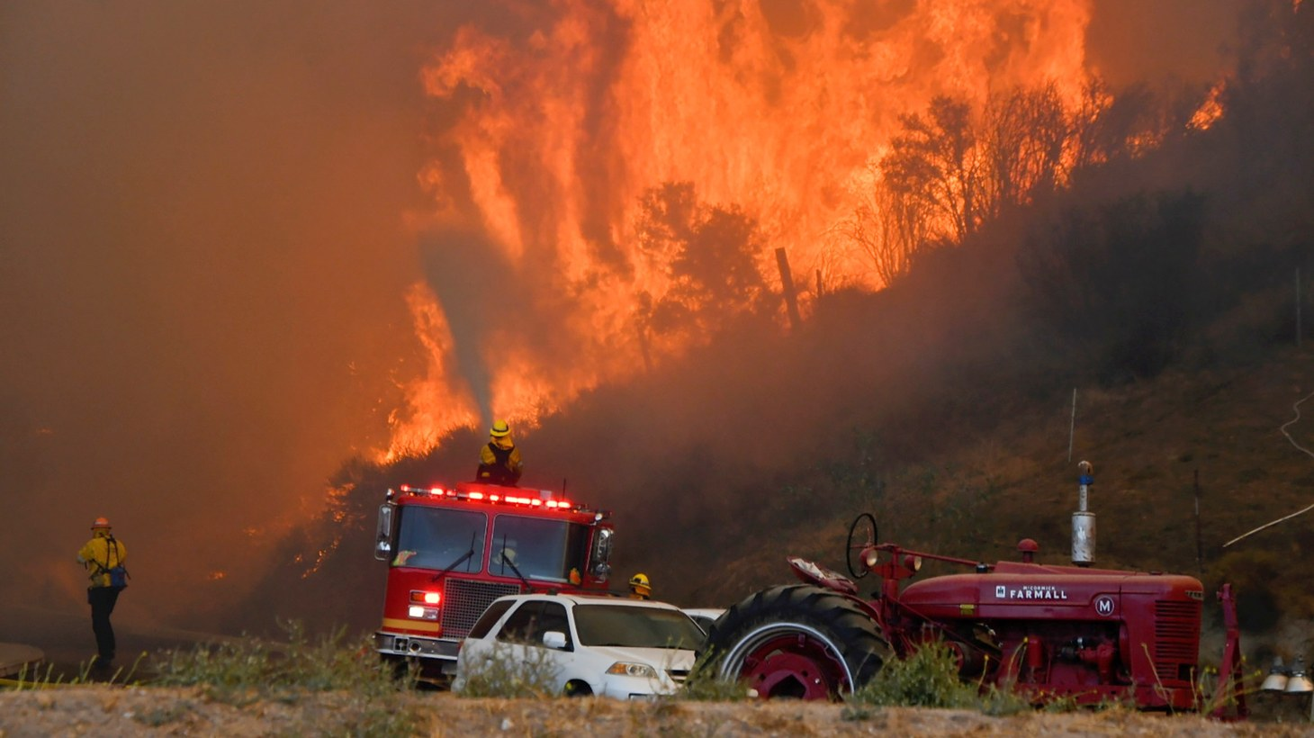 Firefighters arrive to battle the Tick fire, a wind driven wild fire in the hills of Canyon Country north of Los Angeles, California, U.S. October 24, 2019.