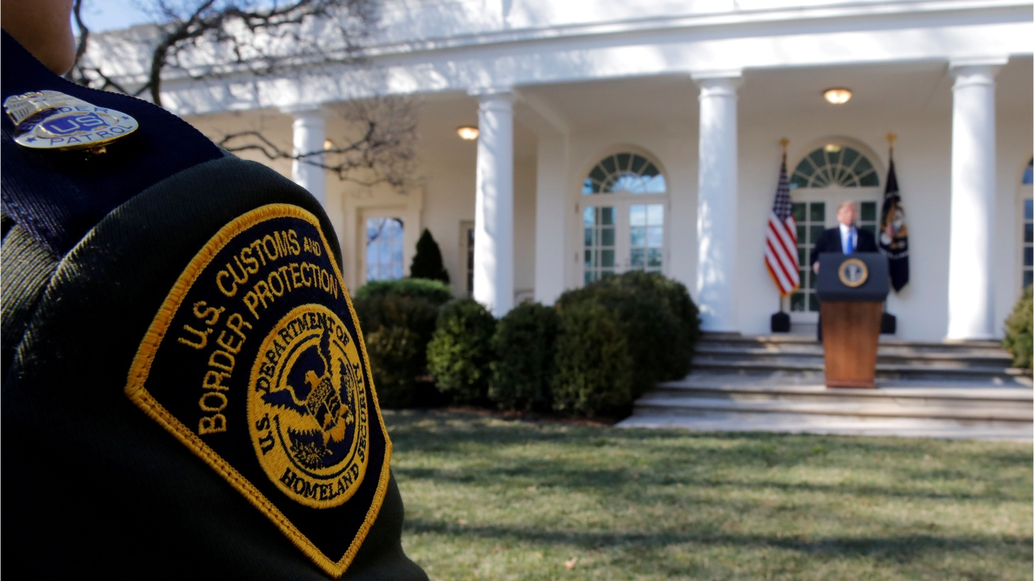 A U.S. Border Patrol agent listens from the front row as President Donald Trump declares a national emergency at the U.S.-Mexico border during remarks about border security in the Rose Garden of the White House in Washington, U.S., February 15th, 2019.