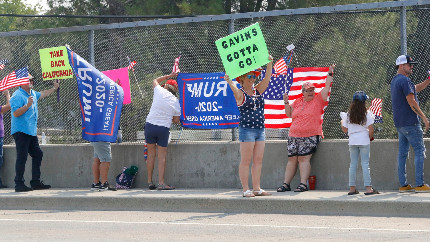 More than a dozen people stood on the Interstate 5 overpass at Hartnell Avenue in Redding as part of the Statewide Overpass Recall Newsom Rally on Saturday, Aug. 29, 2020. Pro-Trump banners also were on display at the rally that promoted a recall of Gov. Gavin Newsom.