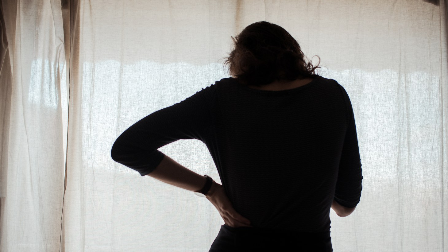 An illustration of a woman in front of a curtain, January 18, 2021, Paris, France. One third of COVID-19 survivors may develop a severe mental health condition within six month of their initial diagnosis, according to Oxford University researchers.