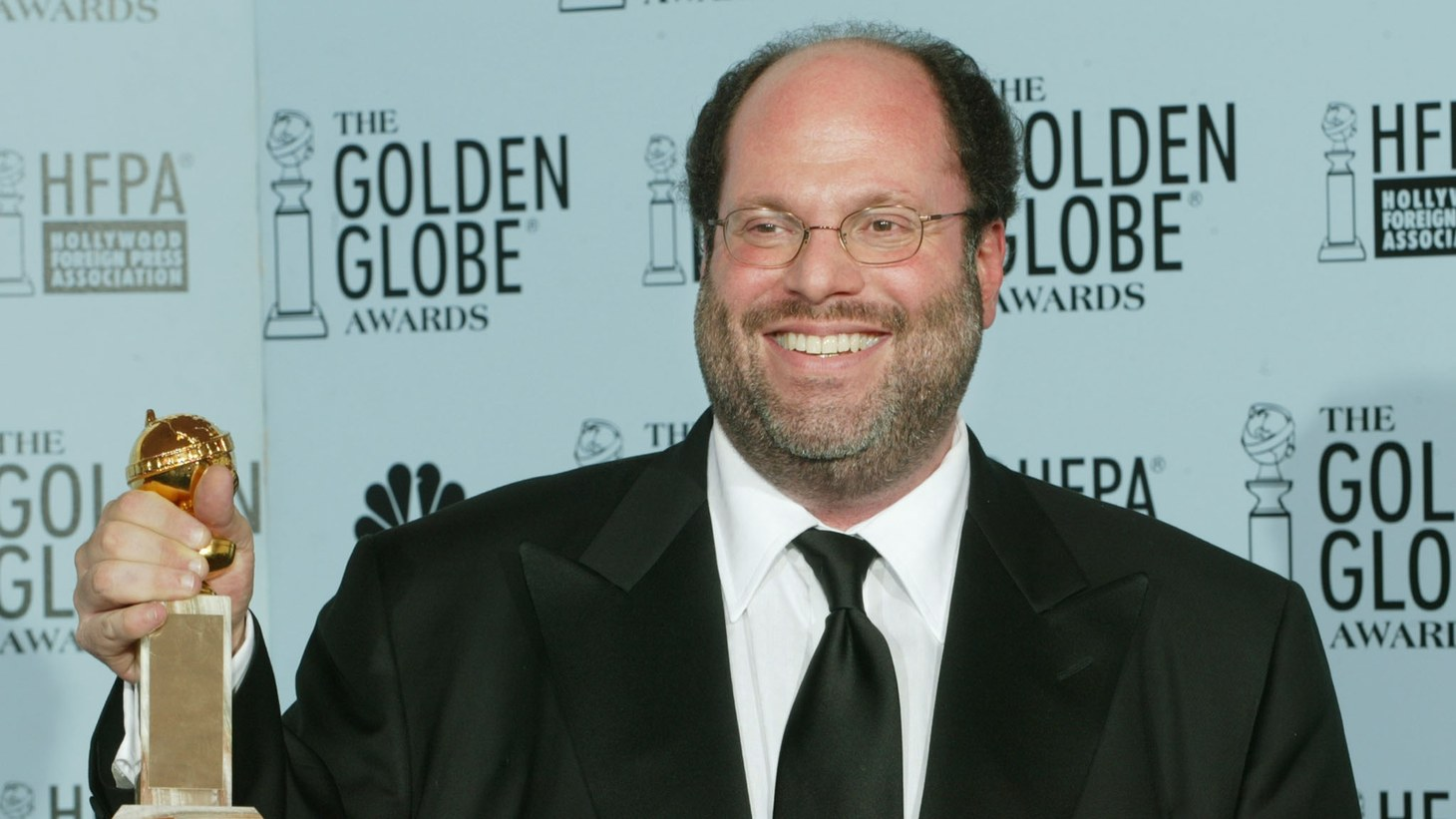 """January 19, 2003: Producer Scott Rudin holds an award he won for his film """"The Hours"""" at the 60th annual Golden Globe Awards in Beverly Hills, California."""