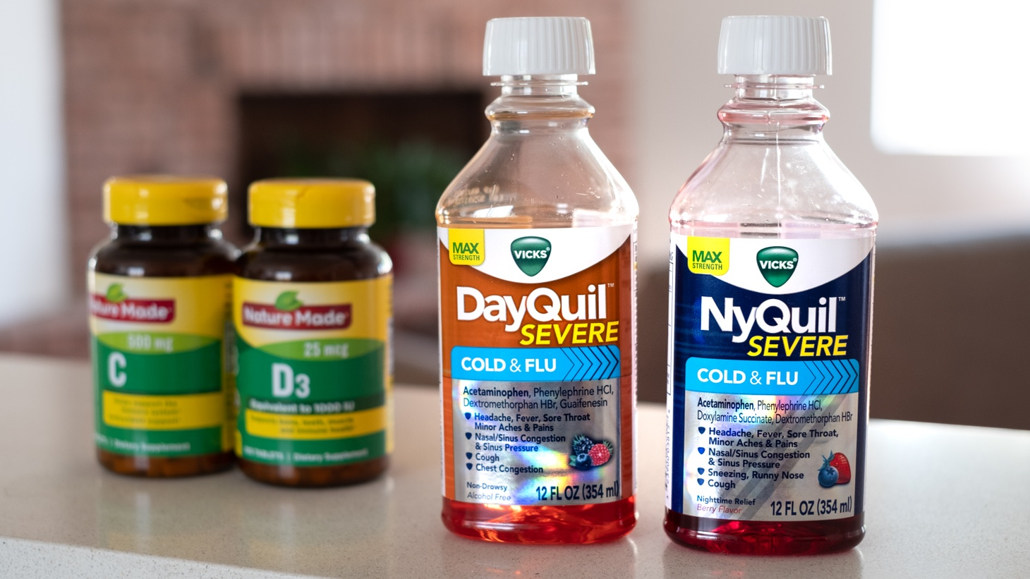 Bottles of cold and flu medicine, plus vitamins, sit on a home countertop. This year is one of the lowest influenza seasons on record, according to the CDC.