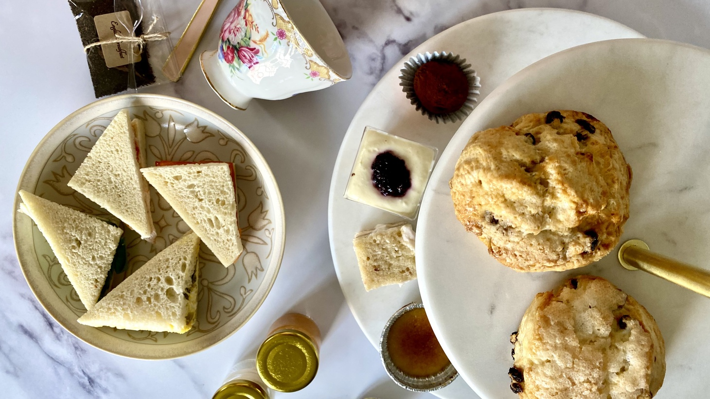 Clementine's Deluxe Afternoon Tea Package comes with loose leaf tea, tea sandwiches, scones, and other sweets. You can set it up like this.