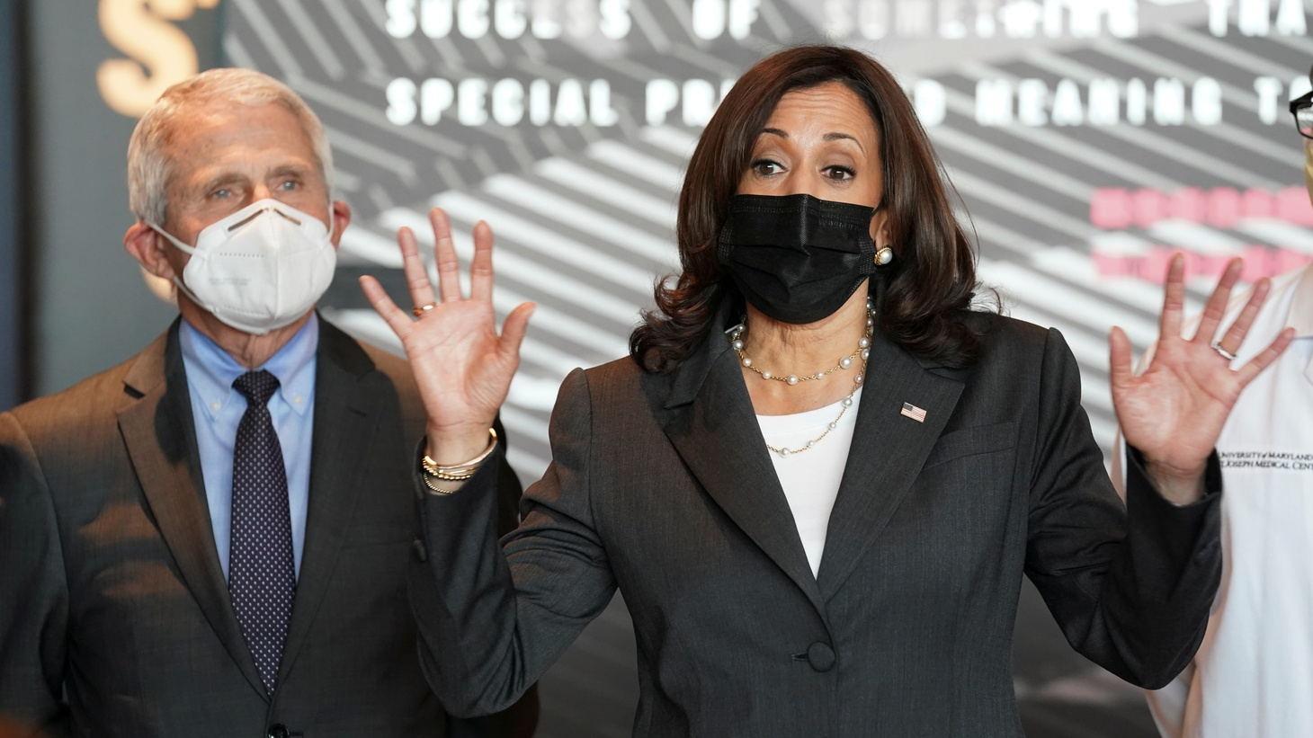 U.S. Vice President Kamala Harris speaks as Dr. Anthony Fauci stands at her side while touring a COVID-19 mass vaccination site at M&T Bank Stadium in Baltimore, Maryland, U.S., April 29, 2021.