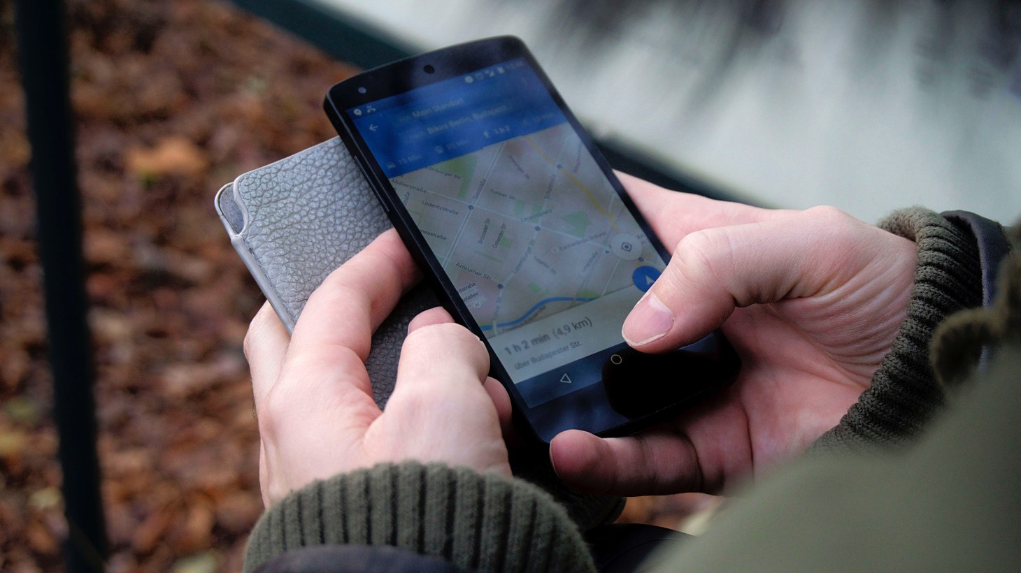 A person using Google Maps on their smartphone.