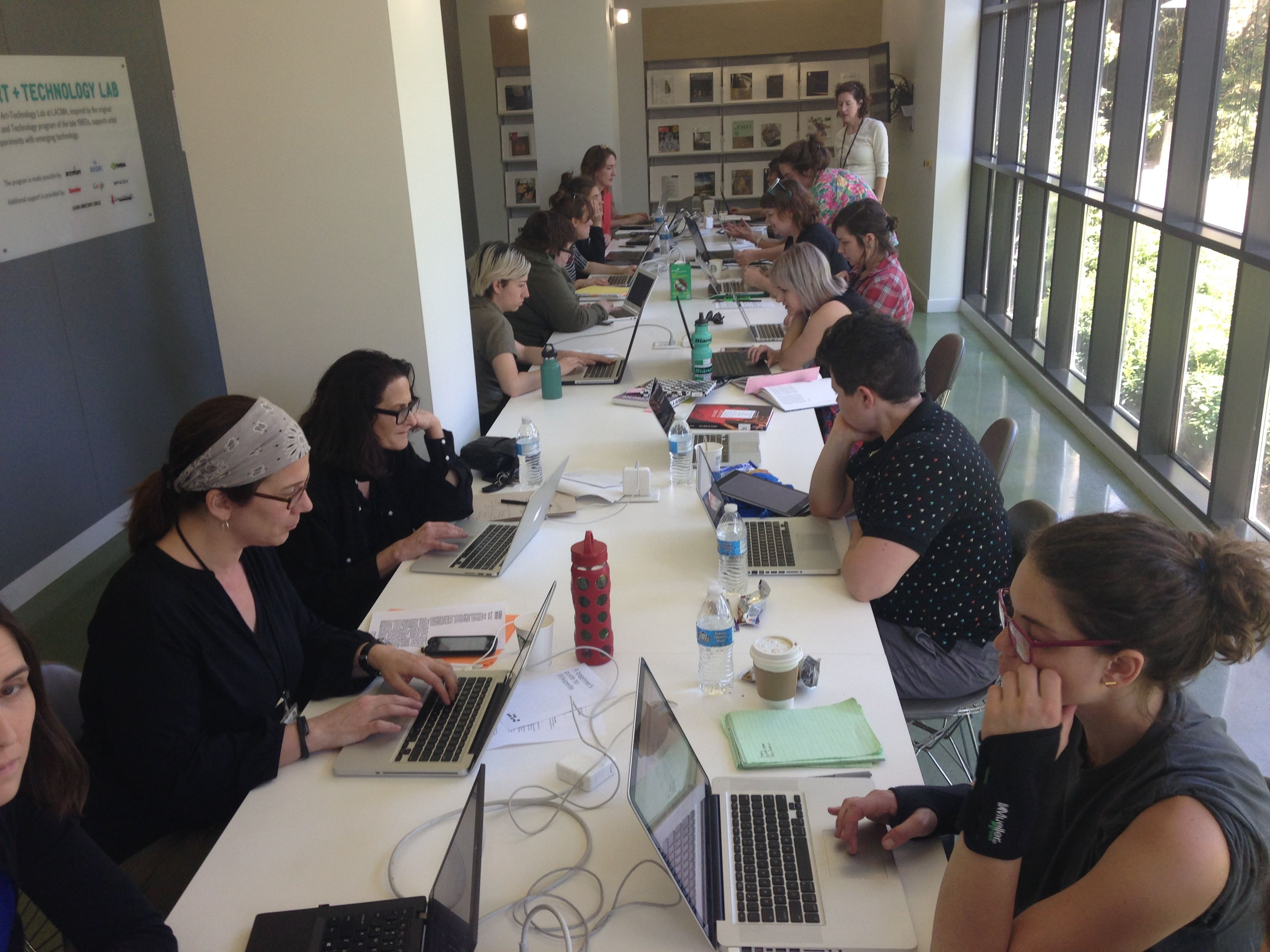 Volunteers editing Wikipedia.