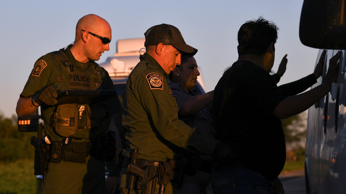 U.S. Border Patrol agents apprehend undocumented migrants after they illegally crossed the U.S.-Mexico border in Mission, Texas, U.S., April 9, 2019.