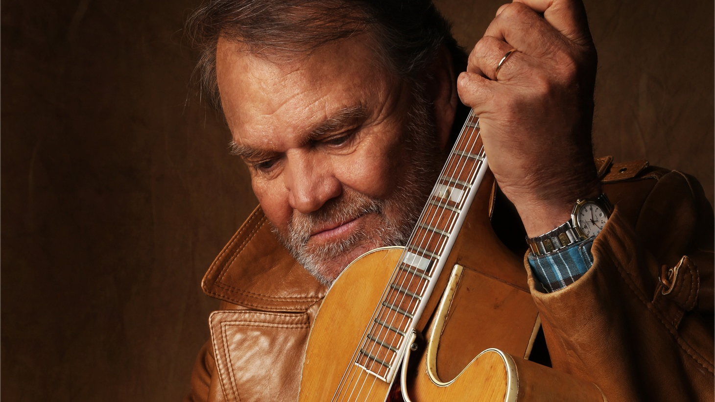 """Glen Campbell was one of 12 children of poor Arkansas sharecroppers. He grew up to release more than 70 albums, win six Grammys, and host his own TV show. Several years ago, Campbell announced he had Alzheimer's Disease. Since then, his family and friends got him into the studio to record one final album, """"Adios."""""""