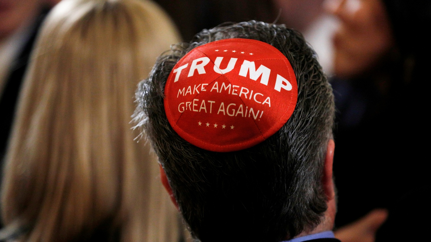 "A participant wears a Trump ""Make America Great Again"" yarmulke as they attend a White House Hanukkah reception where U.S. President Donald Trump signed an executive order on anti-semitism in the East Room of the White House in Washington, U.S., December 11, 2019."
