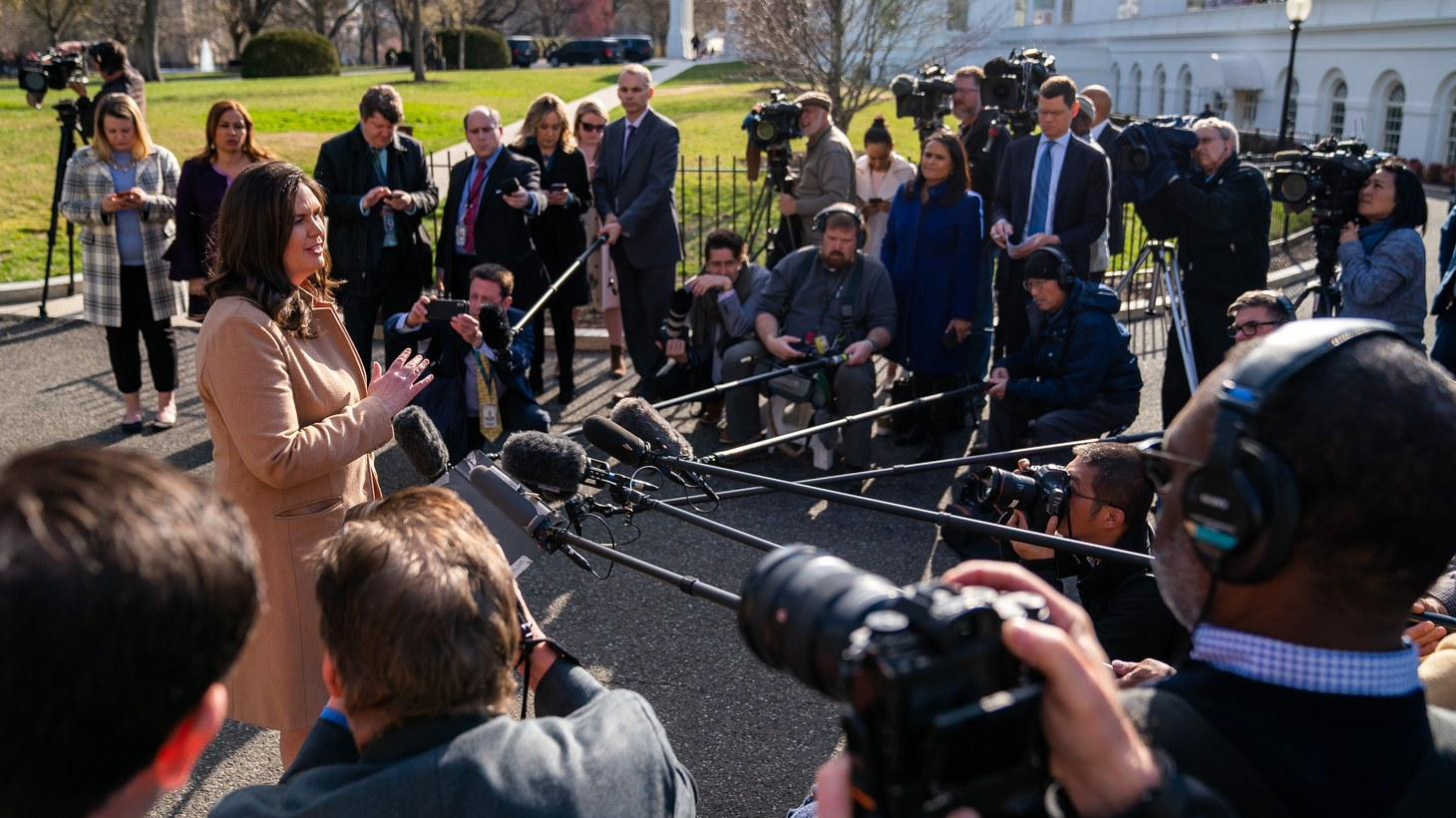 White House Press Secretary Sarah Sanders meets with reporters Monday morning, March 25, 2019, on the driveway outside the West Wing entrance to the White House.