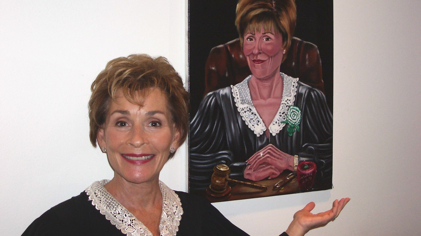 Judge Judy with a painting of herself.