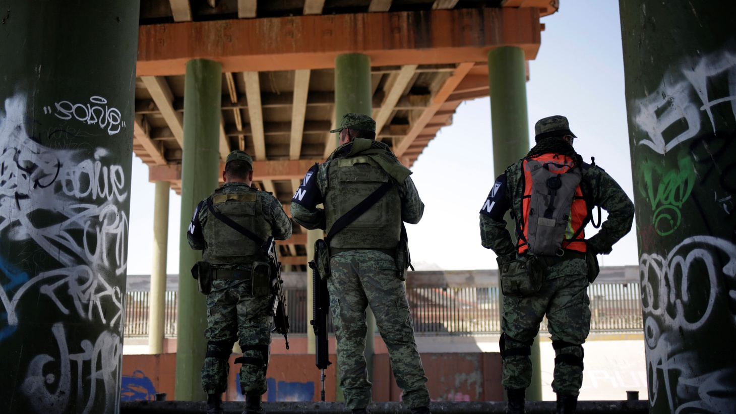 Members of Mexico's National Guard stand under the Paso del Norte International bridge that connects the U.S. and Mexico, as part of an ongoing operation to prevent migrants from crossing illegally into the United States, in Ciudad Juarez, Mexico June 24, 2019.