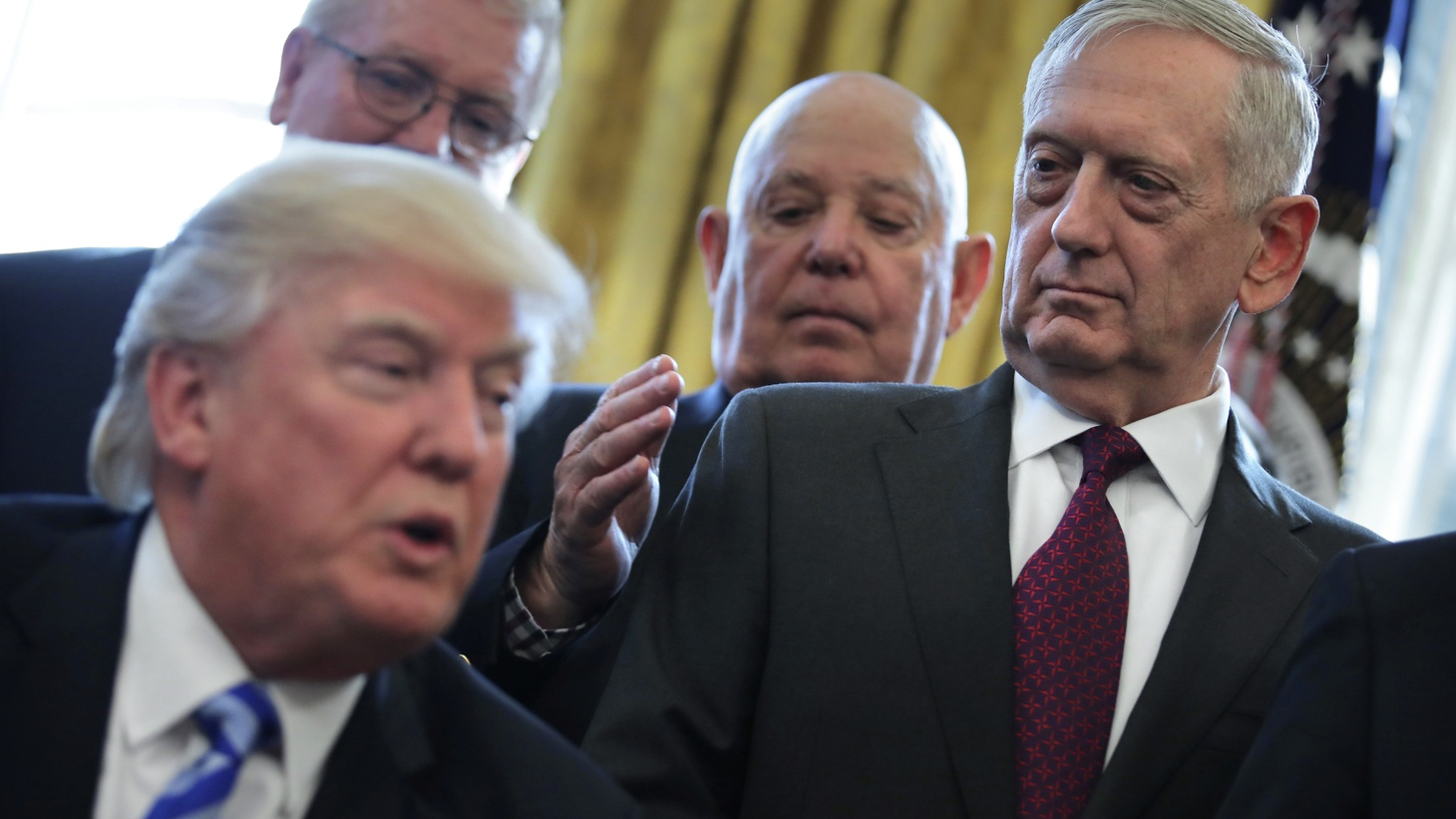 Defense Secretary James Mattis looks at President Donald Trump as he speaks during a meeting with Medal of Honor recipients in the Oval Office of the White House in Washington, March 24, 2017.