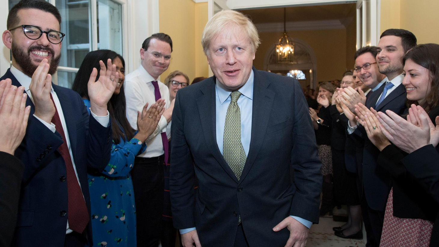 Britain's Prime Minister Boris Johnson is greeted by staff, arriving back at Downing Street, after meeting Queen Elizabeth and accepting her invitation to form a new government, in London, Britain December 13, 2019.