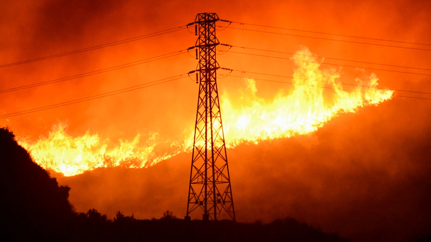 A wind-driven wildfire burns near power line tower in Sylmar, California, U.S., October 10, 2019.
