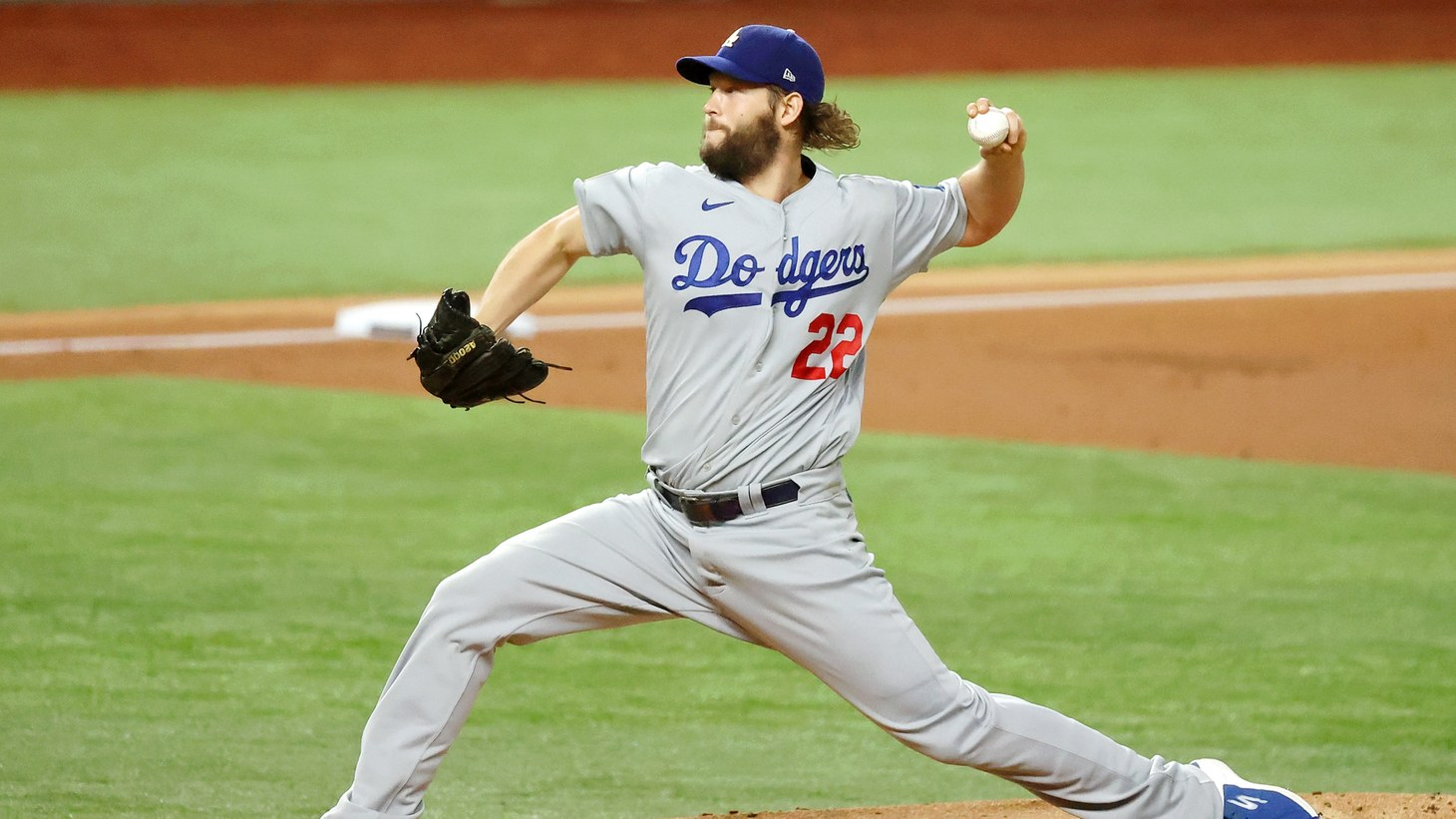 LA Dodgers starting pitcher Clayton Kershaw (22) pitches against the Tampa Bay Rays during the first inning during game five of the 2020 World Series at Globe Life Field.
