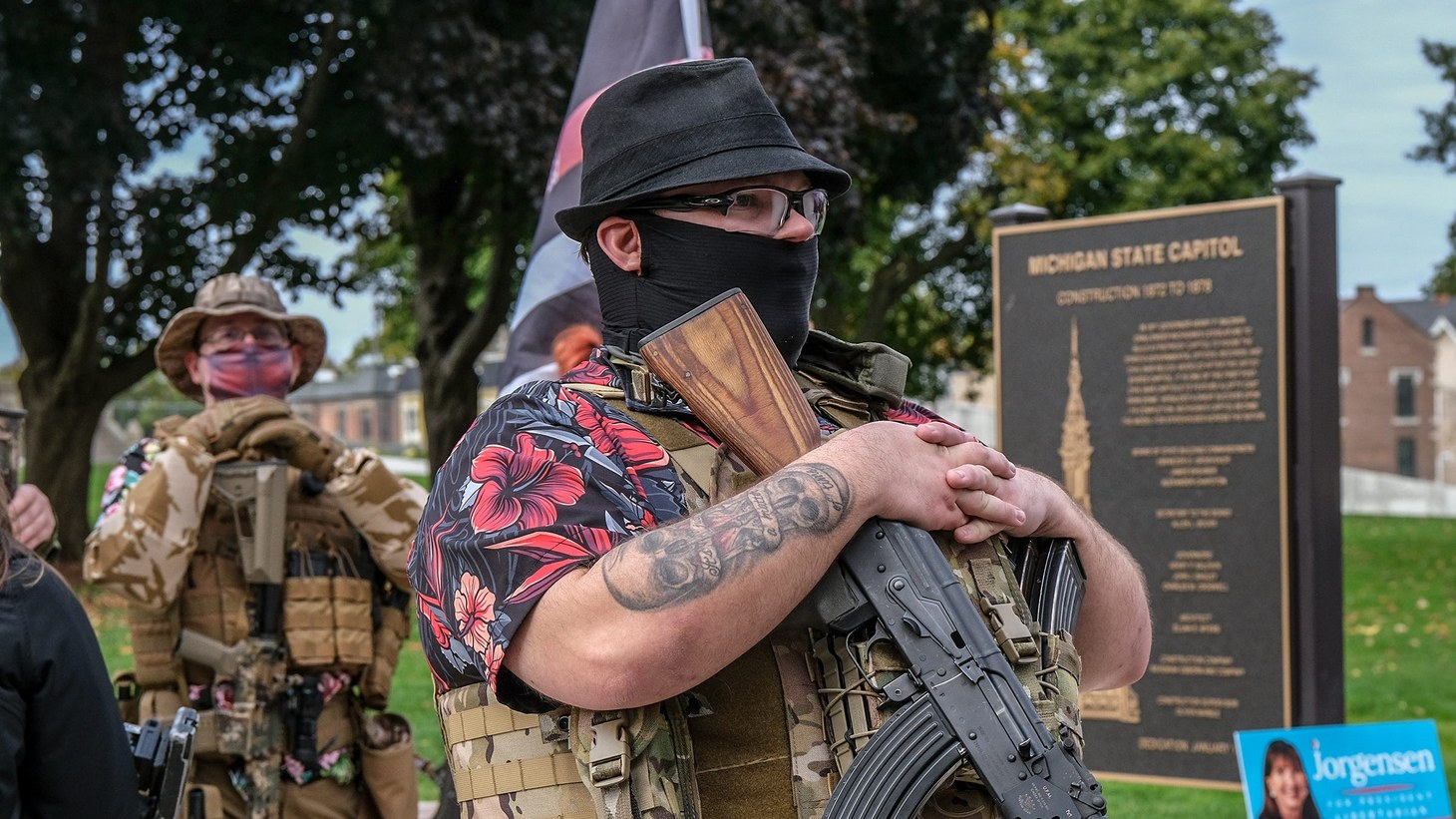 Heavily armed men and women of the Boogaloo Bois movement rally at the Michigan State Capitol on Oct. 17, 2020.