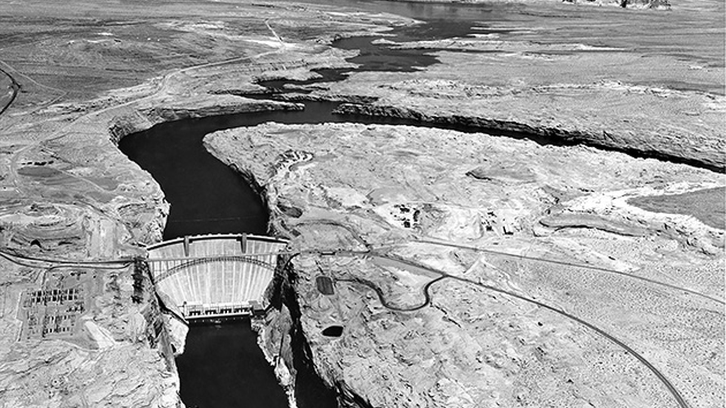 The Glen Canyon Dam is an enormous structure located near the Utah-Arizona border about twenty miles north of the Grand Canyon. It was built to harness and store Colorado River water for surrounding states, and to generate clean energy to power the region.
