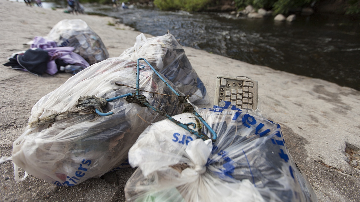 Bags of trash and waste removed from the Los Angeles river.