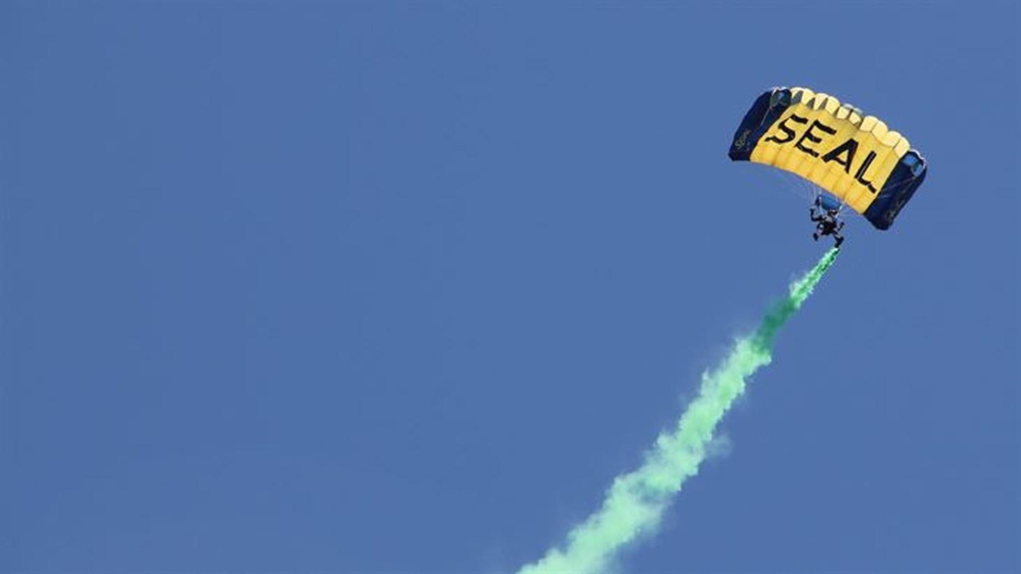 A Navy seal parachutes down to Marina Green, San Francisco, 2014.