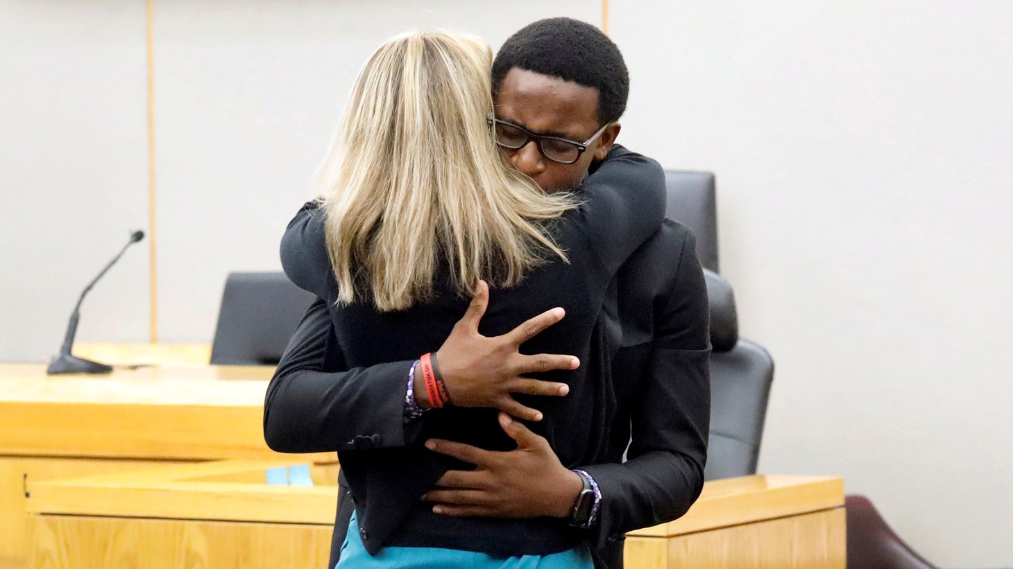 Botham Jean's younger brother Brandt Jean hugs former Dallas police officer Amber Guyger after delivering his impact statement to her following her 10-year prison sentence for murder at the Frank Crowley Courts Building in Dallas, Texas, U.S. October 2, 2019.