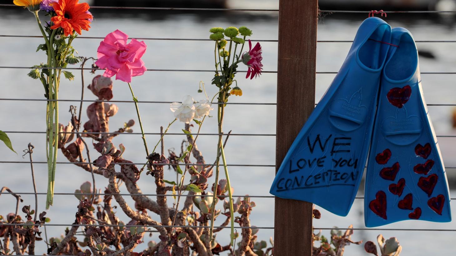 Flowers are seen at a makeshift memorial near Truth Aquatics in Santa Barbara, California, September 2, 2019.