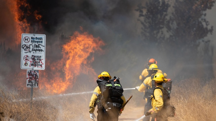 Cal Fire says in total, more than two dozen major wildfires are burning across the state as of this morning.