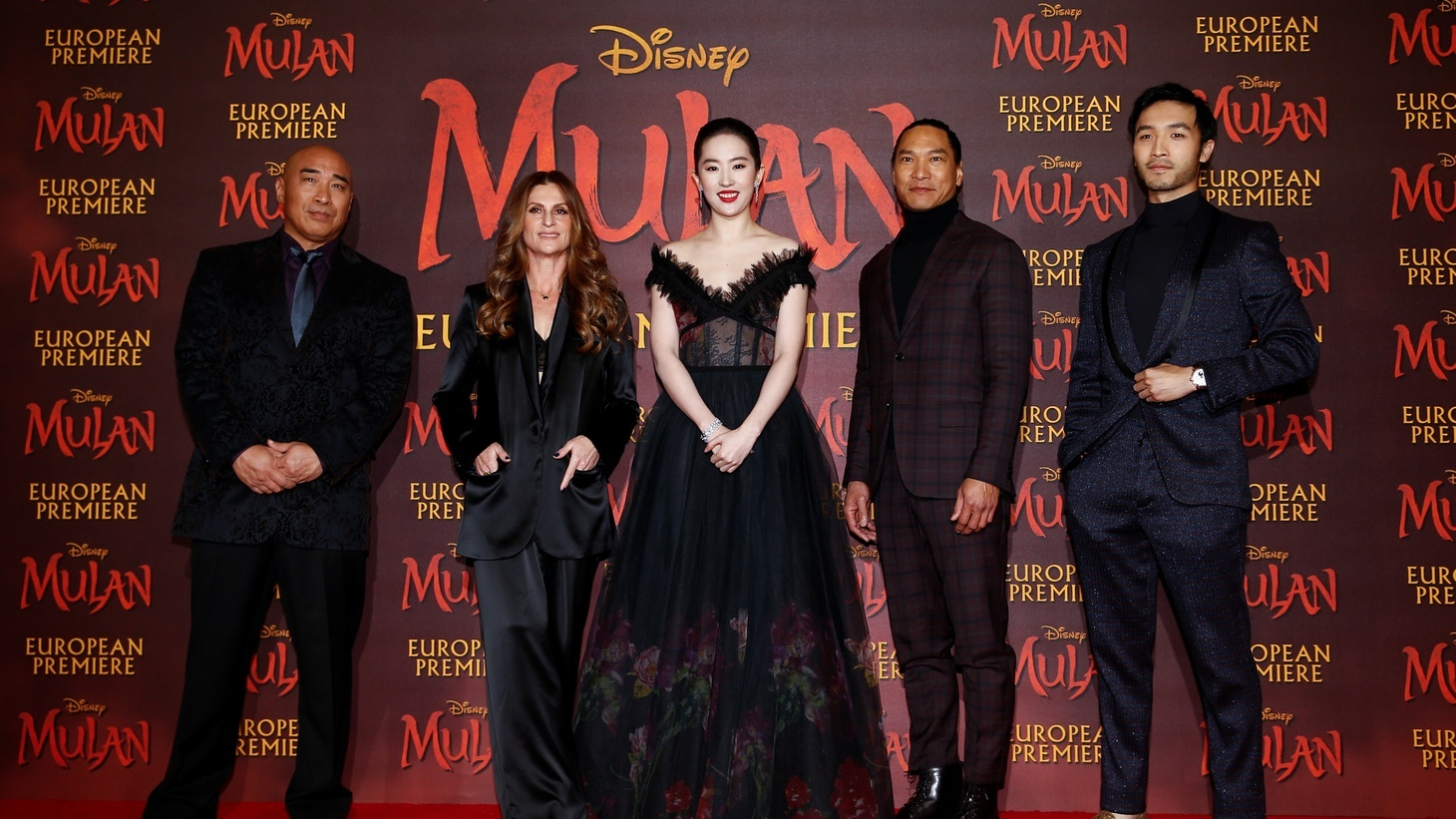 "Cast members Ron Yuan, Yifei Liu, Jason Scott Lee and Yoson An pose with director Niki Caro, at the European premiere for the film ""Mulan"" in London, Britain, March 12, 2020."
