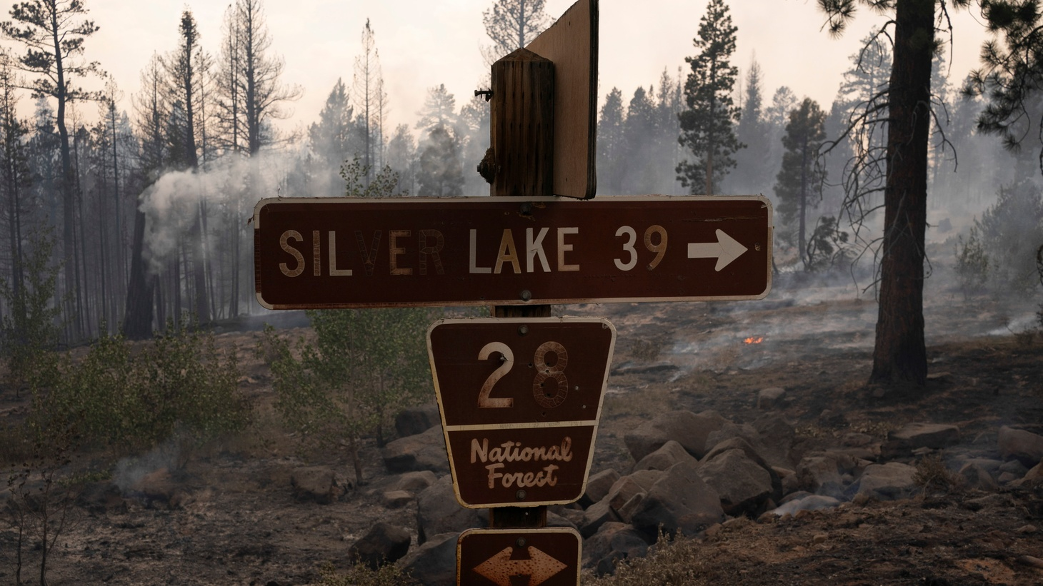 A sign burned by wildfire is seen as the Bootleg Fire burns through vegetation near Paisley, Oregon, U.S., July 20, 2021.