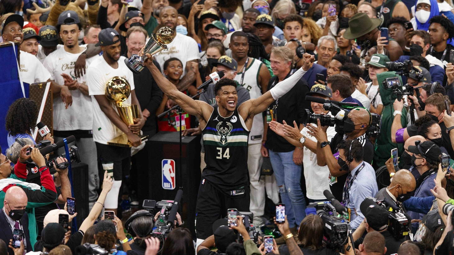 Milwaukee Bucks forward Giannis Antetokounmpo (34) celebrates with the NBA Finals MVP Trophy following the game against the Phoenix Suns.